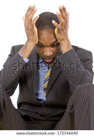 young black businessman stressed or depressed about failure - stock photo
