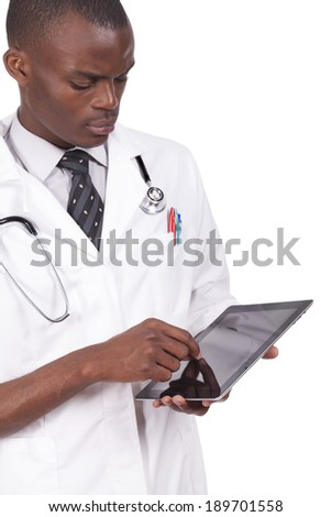 Young black doctor looking at tablet