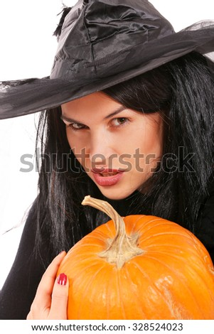 young black dressed witch with pumpkin on a white background