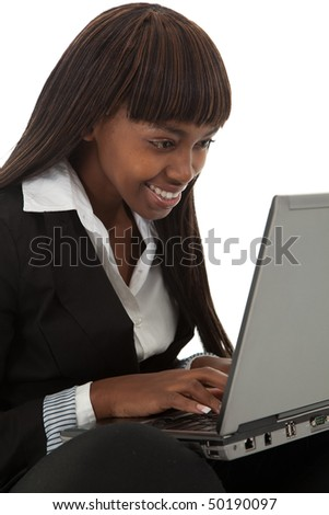 Young black female professional looking at something funny on laptop screen