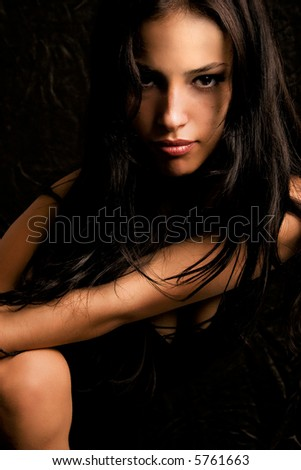 young black hair woman portrait on dark background