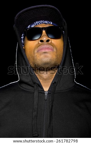 young black male wearing shades and hood is a criminal or misunderstood urban youth - stock photo