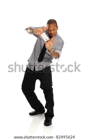Young Black Man holding a cell phone isolated on a white background