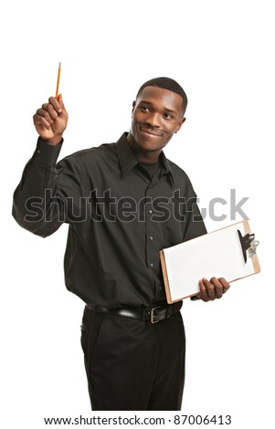 Young Black Man Holding Clipboard Pointing, Smiling Isolated on White Background
