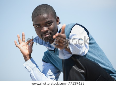 Young black man on open air. Guy posing outdoors - stock photo