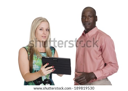 young black man with a young white blond woman looking at a tablet in studio on a white background  - stock photo