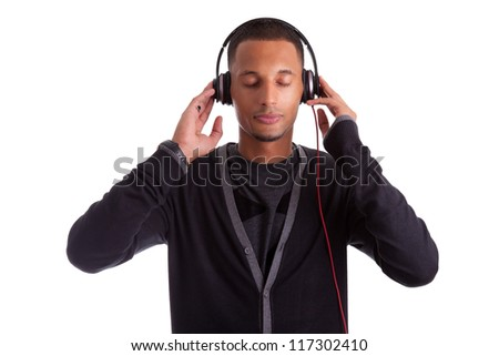Young black man with closed eyes listening to music, isolated on white background