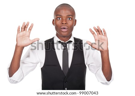 young black man with his hands up and looking scared