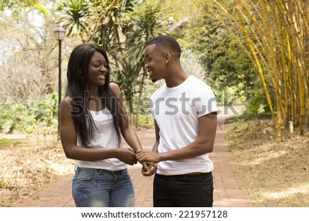 Young Black woman closing her eyes while boyfriend propose - stock photo