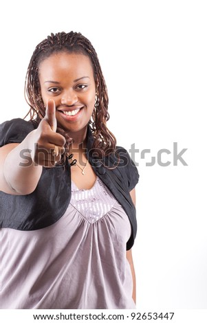 Young black woman giving a thumbs up sign - isolated over white background - stock photo