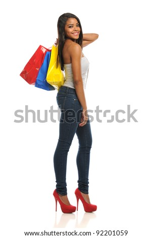 Young Black Woman holding shopping bags isolated on a white background - stock photo