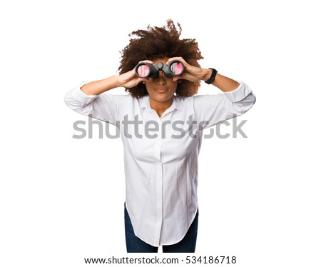 young black woman looking through the binoculars