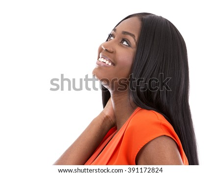 young black woman wearing bright dress on white background - stock photo
