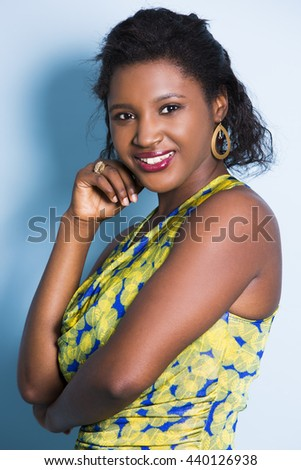 young black woman wearing casual outfit on light blue background