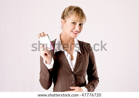 young blond business woman with a chocolate bar