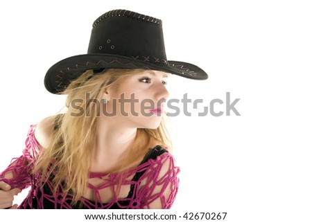 Young blond fashionable cowgirl posing in studio isolated