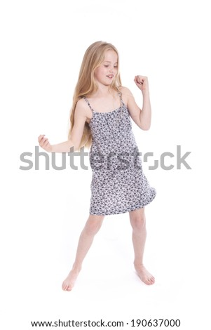 young blond girl dancing in studio against white background - stock photo