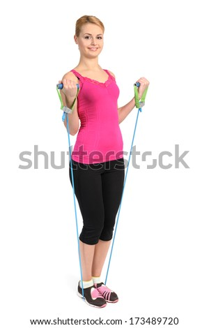 Young blond girl doing female biceps exercise using rubber resistance band. position 2 of 2. - stock photo