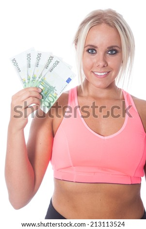 young blond girl in pink and black sportswear holding five hundred Euro banknotes in her right hand - stock photo