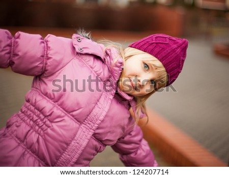 young blond girl in playground