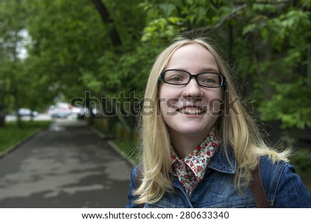 """Young blond girl in the park. """"Real People"""" series - stock photo"""