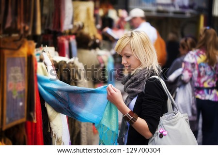 Young blond girl shopping some muslim goods.