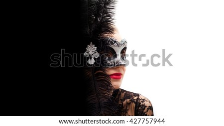 young blond hair woman with black swan carnival Venice mask.