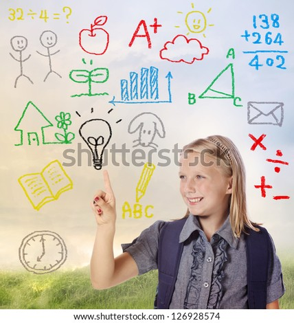Young blond school girl with hand written school themed texts and pictures - stock photo