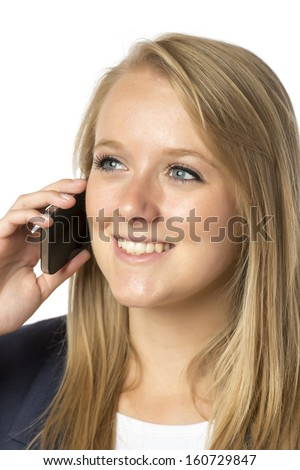 Young blond serious woman in business dress phoning with her mobile phone