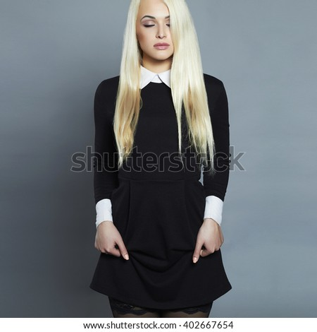 Young blond sexy woman.Beautiful Girl in schoolgirl dress - stock photo