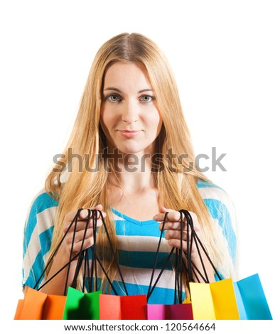 Young blond surprised woman after shopping - stock photo