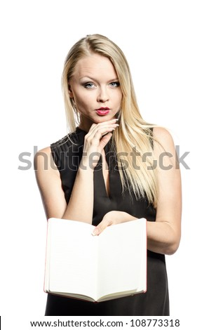 Young blond thoughtful with notebook in black - stock photo
