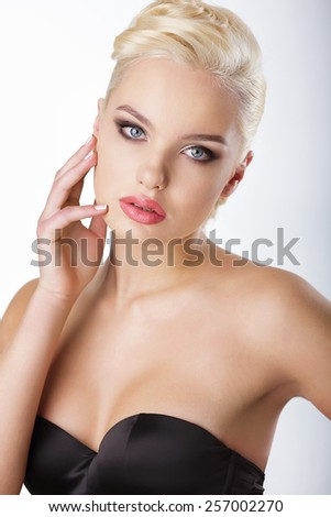 Young Blond Touching her Face with Clean Healthy Skin - stock photo