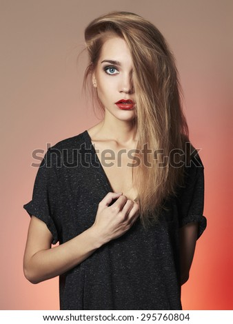 Young blond woman.Beautiful blonde Girl.Make-up and red lips - stock photo