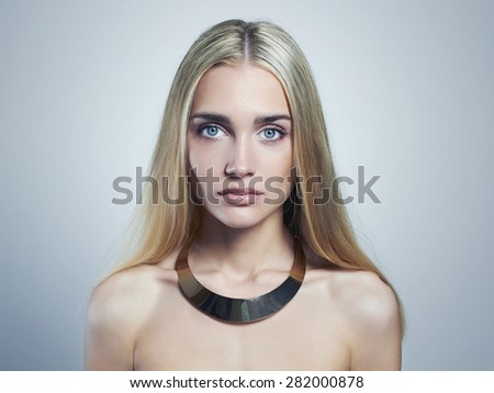 Young blond woman.Beautiful Girl.close-up fashion portrait.blonde in necklace - stock photo