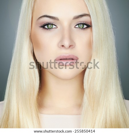 Young blond woman.Beautiful Girl.close-up make-up portrait.green eyes - stock photo