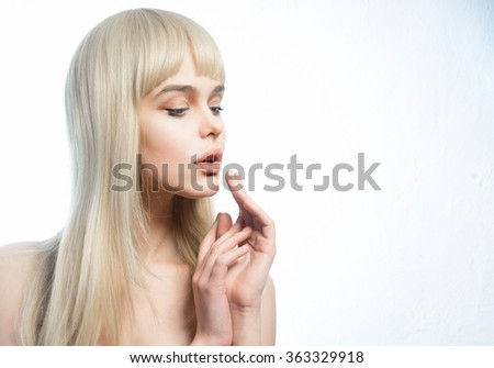 young blond woman close-up on a white background