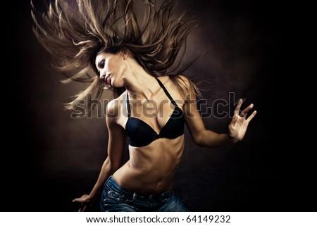 young blond  woman dancing  studio shot - stock photo