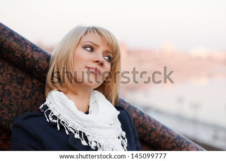 Young blond woman daydreaming