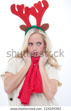 young blond woman disguised as an elk pouts, blond woman with antlers sulks  , woman with horns sulks