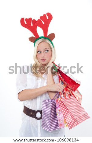 young blond woman disguised as an elk with shopping bags/young blond woman disguised as an elk/young woman with horns