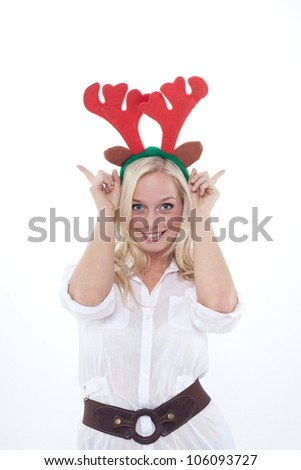 young blond woman disguised as an elk/young blond woman with antlers /young woman with horns
