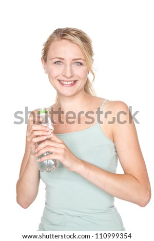 young blond woman drinking water after sport - stock photo