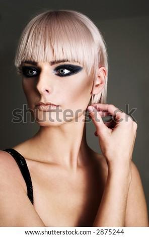 Young blond woman, evening makeup - stock photo