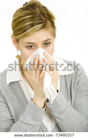young blond woman having a cold
