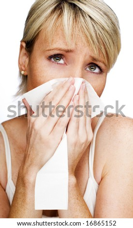 young blond woman having a cold close up - stock photo