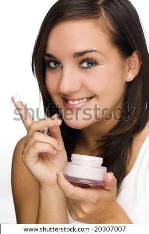 young blond woman holding creme on white - stock photo