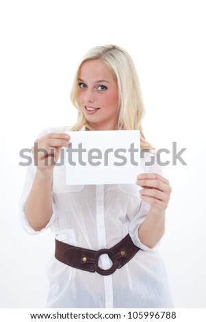 young blond woman holds  an empty sheet for an advice/young blond woman holds an empty sheet /woman with empty sheet