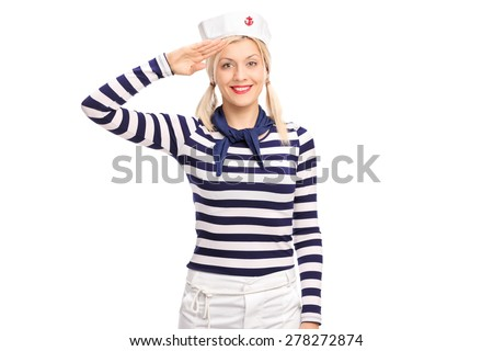 Young blond woman in a sailor outfit saluting towards the camera and smiling isolated on white background - stock photo