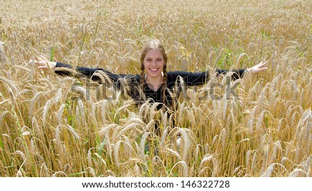 Young blond woman in a wheat field